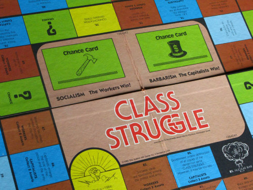 "OBJECT OF THE GAME:  ""Class Struggle"" reflects the real struggle between the classes in our society. THE OBJECT OF THE GAME IS TO WIN THE REVOLUTION … ULTIMATELY. Until then, classes—represented by different players—advance around the board, making and breaking alliances, and picking up strengths and weaknesses that determine the outcome of the elections and general strikes which occur along the way.   ""Class Struggle"" can be played by two to six players. THE REAL PLAYERS IN ""CLASS STRUGGLE,"" HOWEVER, ARE CLASSES, not individuals. Workers (those who produce shoes, cars, houses and so on) and Capitalists (those who own the machines and factories with which these things are produced) are the Major Classes. Farmers, Small Businessmen, Professionals (doctors, lawyers, professors, etc.) and Students are the Minor or Allied Classes. In the game, the hammer symbolizes the Workers, the top hat—the Capitalists, the tractor—the Farmers, the cash register—the Small Businessmen, the brief case—the Professionals, and the mortarboard—the Students.  Created by NYU professor Bertell Ollman in 1978, Class Struggle: The Game looks like a cheeky adaptation of Monopoly (made abundantly clear by the fact that Karl Marx is arm wrestling Nelson Rockefeller on the cover). So: question. Should we see Class Struggle: The Game as as a useful pedagogical tool to mobilize would-be revolutionaries or more as a leisurely, bourgeois way to pass the time until the revolution inevitably washes over the armchair revolutionaries? Yes, I'm being cheeky."