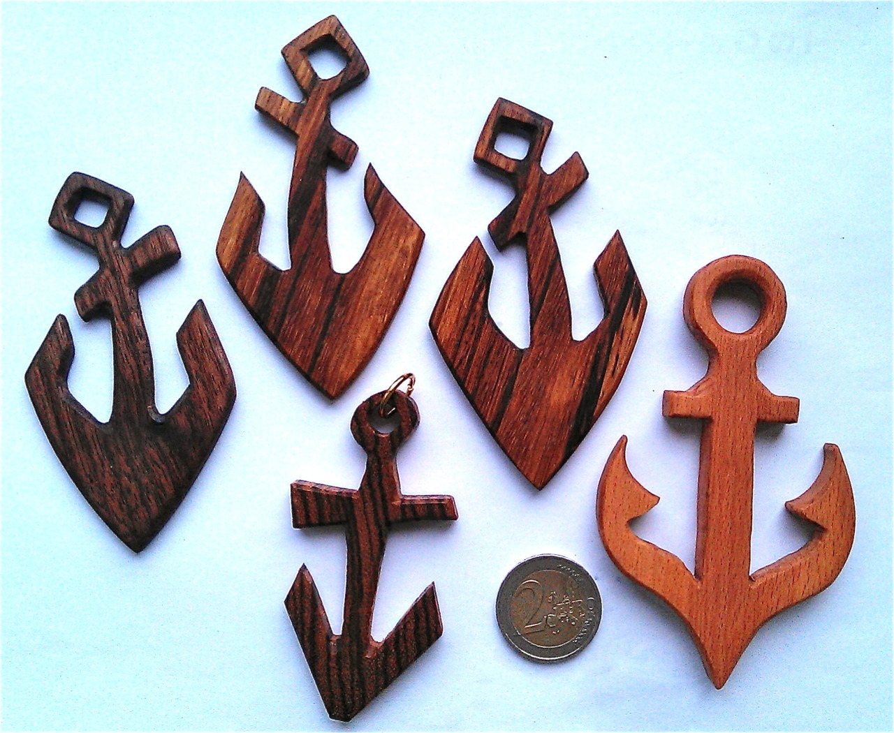 some anchor necklaces. zebrawood, american nutwood and beech wood.i am able to make any anchor shape in any given wood  order ->  www.facebook.com/pavianplugsorganics