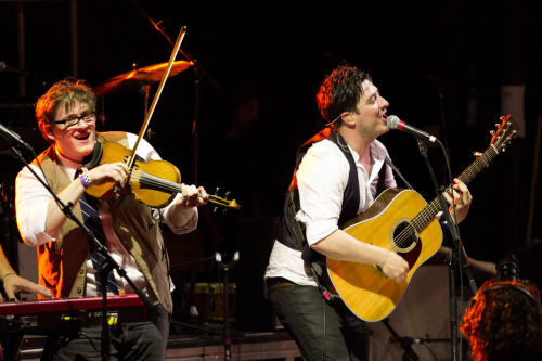 Marcus Mumford and Ross Holmes of Mumford & Sons perform at SXSW in Austin, Texas after the second screening of Big Easy Express on March 17, 2012. Photo courtesy of Vincent Nguyen.