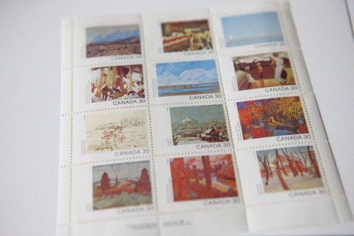 a lovely set of canadian stamps featuring provinces paired with paintings.