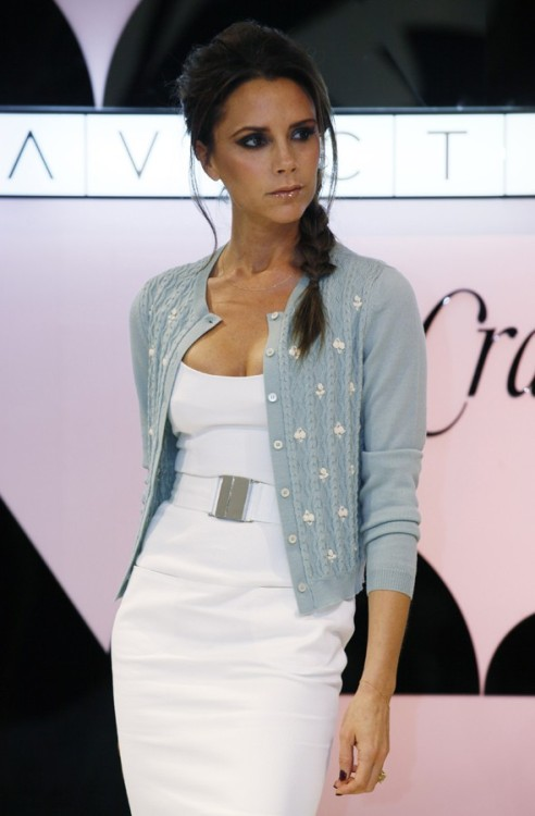 Cardi Girl: Victoria Beckham White + ice blue= your new spring color combination. Mrs. Beckham steps out in the refreshing hues during a promotional tour for her clothing line in Hong Kong. Photo: mydaily