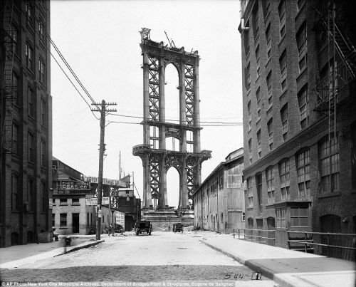 vintagenyc:  Genesis of a icon: In this June 5, 1908 photo, the Manhattan Bridge is less than a shell, seen from Washington Street. It wouldn't be opened for another 18 months and wouldn't be completed for another four years