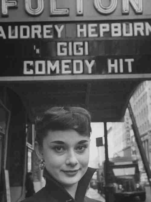 Audrey Hepburn posing under a theater marquee for the stage version of 'Gigi', 1951. (My favorite film) ;)