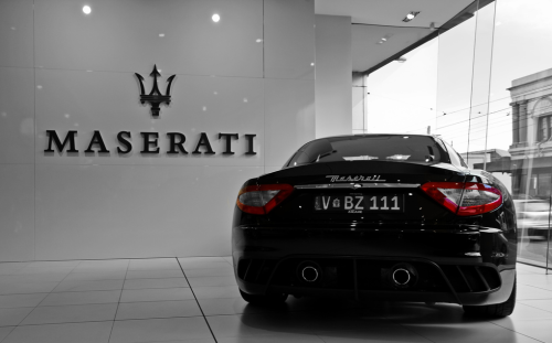 Maserati GranTurismo being pretty in a showroom. Photo by Tom Fraser.