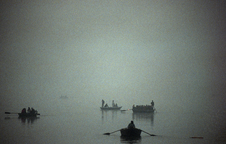 delucazade:  Hindu pilgrims take rowing boats out onto the River Ganges during a misty morning in Varanasi Petrut Calinescu