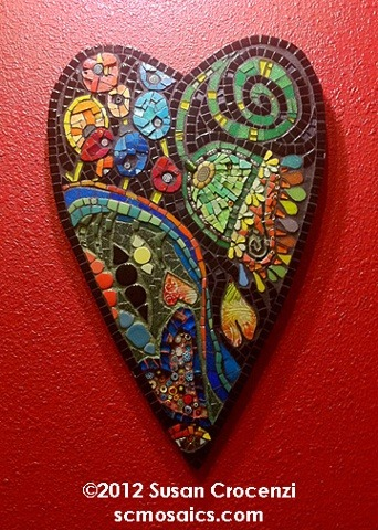 flingingmud:  Thee's Something Free Inside Me 2012 mosaic 19 x 12 Wall-hanging 19 x 12 I've been salivating on a book of Pucci patterns and it had an influence on this piece. I'm also a huge fan of surrealism: I love their use of hidden and incongruous symbols. Their work is meaty; so much to see and puzzle over. Since hearts are regularly dismissed as overdone and/or sappy, it was important to me to convey the complex, idiosyncratic, and exuberant nature of the symbol. Ceramic, glass, smalti, millefiore. (via Susan Crocenzi, Contemporary Mosaic Art - Thee's Something Free Inside Me)