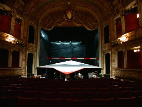 fuckyeahgreatplays:  This was the set for The Berliner Ensemble's production of Die Mutter. It was experimental, roughly 3 hrs, and in German, so I didn't understand a word of it, but holy shit this stage: a raked platform (had to be roughly 5-6ft off the ground at the back) coming to a point. Towards the end of the play, the mother walked upstage slowly, slowly, in near-darkness. It was silent. Looking like she was going to walk straight off the upstage edge, she tripped and crumpled. Hard to tell if it was scripted or not. The whole audience sucked in their breath. She didn't get up. She didn't get up. She got up. THAT was a fuckin present audience. THAT is some theatrical magic.
