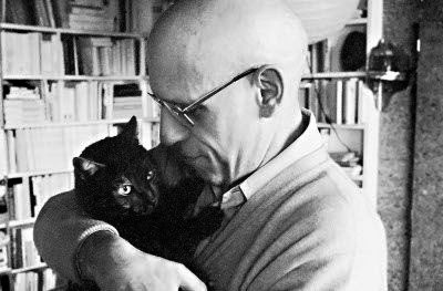 Michel Foucault and his cat 'Insanity'.