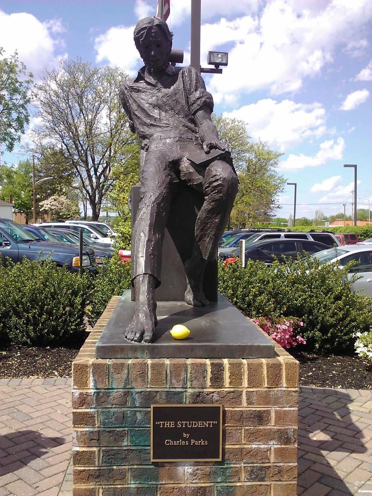221b-bagend:  This statue sits in front of the Newark Free Library in Delaware, which is one of my favorite places. Libraries are just so special to me, because I've loved reading and books my whole life, and while the library is pretty small, particularly in comparison to bigger city libraries, it still has these amazing cubbyholes with comfy chairs and these awesome glass cases where they show local pieces, like art from the high schools around here, and historical tools. I thought it was really fitting to take this picture in front of a library, particularly one where I've spent so much time and love dearly, because of John Finnemore's amazing way of manipulating words and grammar for comedic effect, and also all the allusions to literature he makes both in Cabin Pressure and John Finnemore's Souvenir Programme. It's one of the main reasons I'm such a huge fan of his. So my message is this: Mr. Finnemore, thanks so much for your radio shows, particularly Cabin Pressure. The episodes are always so phenomenal, and the reader in me loves all the allusions to novels! Much love from Newark, Delaware, United States.♥ Cassie my contribution to the Lemons in Landmarks Project :)  OMG There's someone else from Newark that's into Cabin Pressure!?!