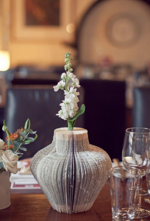 fuckyeahweddingideas:  A vase made from book pages…it even has a flower in it!  Sweet.