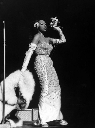 Do you ever get enough of Josephine Baker? I don't! Here, she is in Christian Dior in March 1951, singing into a mic which conceals her hand-held corsage onstage at the Strand theater in New York during her US tour. Photo: Alfred Eisenstaedt//Time Life Pictures/Getty Images.
