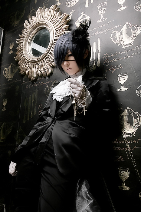 Tea and cutlery oh my! Not only is this a pretty awesome cosplay of Ciel from Black Butler, but the atmosphere of this cosplay photo is fantastic. Look at how absolutely perfect that background wallpaper is. All the tea and cutlery seems like just the type of things one-hell-of-a-butler would have at hand.   sendouakira:  cant think of anything else atm Tahaha as Ciel Phantomhive from Kuroshitsuji