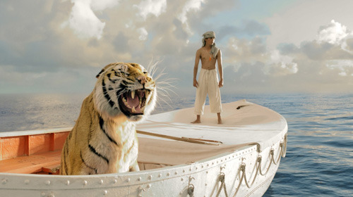 colamonstrosity:  totalfilm:  First look at Ang Lee's Life Of Pi Life Of Pi, Ang Lee's take on Yann Martel's novel of the same name, has released a first official image featuring the titular Pi and his tiger companion, Richard Parker.The film will tell the story of a young boy who finds himself stranded at sea for a mammoth 227 days. However, he's not out there alone, as he has the aforementioned tiger as well as a hyena, a zebra and an orang-utan for company.   That shot looks so Tarsem. Hmm.