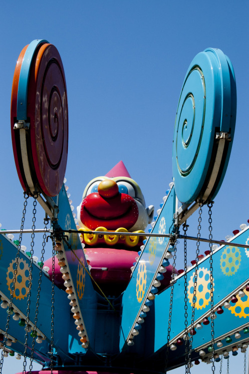 Davis Carnival, IV: Creepy Clown in the Center of the Neverland Swings Ride. Davis, 04-22-12.