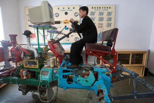 Surely it's easier to lean on the real thing?  A North Korean student learns to drive a tractor on a computerized driving simulator at the Samjiyon Schoolchildrens' Palace in Samjiyon, North Korea. The facility was built for children to take part in after school programs in the arts, sciences, sports, computer and vocational training. (David Guttenfelder/Associated Press) (via North Korea marks 100th anniversary of founder's birth - The Big Picture - Boston.com)