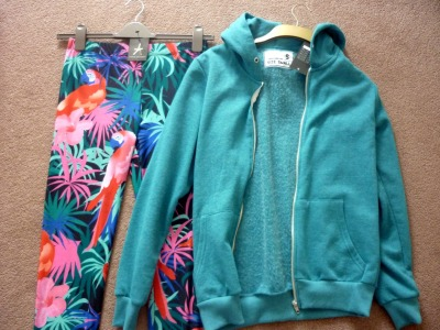 My High St Picks- (From) Primark As of pre- 25th of April, I had been going through a bit of a 'new clothes' drought. I hadn't bought anything for what felt like months, and after an unlucky set of shopping trips which reaped no gain, I was getting restless. Of course I relish retail therapy as much as the next person, but I enjoy it even more when I end up with achy wrists due to the sheer amount of  strength required to drag my bits and pieces home. That, my friends is when I know I've done well. Now I won't claim that I had the most successful shopping trip of all time yesterday, as my best friend and I only bought things in Primark, but we did manage to bag some gems. First things first the Primark I'm casually dropping into conversation just so happens to be the mother of all Primark's (aka, Oxford Circus) which is literally the busiest shop on the planet. Within five seconds I felt overcome with sardine syndrome and making your way through crowds of clothes with a trillion others isn't exactly a laugh a minute. But, what made the trip so worthwhile were these BEA-UTIFUL parrot leggings. Have you ever seen such a delight in your life?! Answer: no.  Apologies for the tiny photo, Photobucket decided to shite all over my dreams with this one. I had to take a punt and buy the things as the queue for the changing room was beyond belief (picture: me, best friend attempting to find a vacant mirror, trying on tops over our tops to decide what to buy? Hilarous yet not so pretty sight) but they exceeded my expectations completely. 1) They're not see through. No pant preview for you lot, I'm afraid. 2) The parrot is positioned on the leg SO expertly that you look like an actual walking talking zoo and 3) They're so fun to wear. Like, seriously fun!  As soon as Club Tropicana weather decides to overcome these dodgy April Showers then a 'Today I'm Wearing' post will be up here like a shot, you mark my words. Until then, an (equally) dodgy floor shot will unfortunately have to do. So, the dets. These leggings were £6- which is officially a big, fat bargain, and the teal men's hoodie, which is so very, very soft was only £12. Score.  So, my advice for today? Head to Primark, and get yourself your own aviary/zoo. These leggings will be whipped out all over the summer months for me, that's for sure!