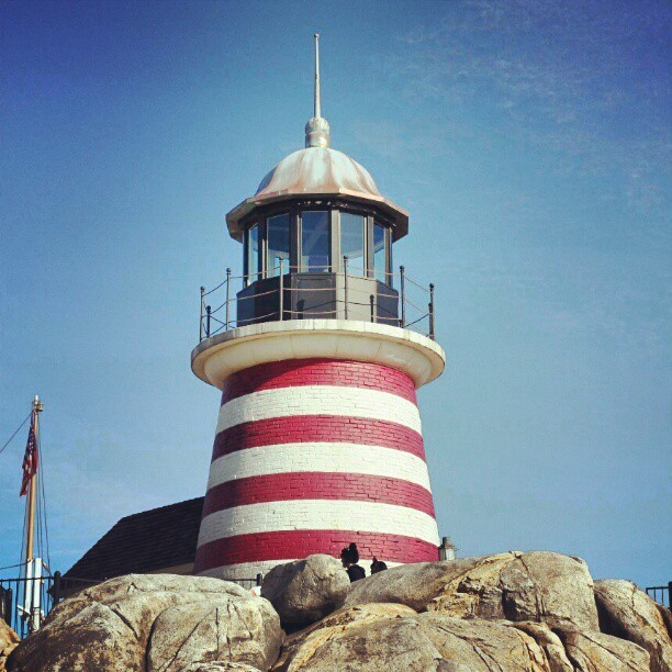 The Lighthouse. It's The Lighthouse in DisneySea Japan. Standing tall in the middle of the man-made lake. Quite lucky to be able to capture this from the boat. It's not just landmark and the lighthouse is very beautiful at night. #Japan #disneysea #Chiba #lighthouse #vacation #holiday #trip  (Taken with instagram)