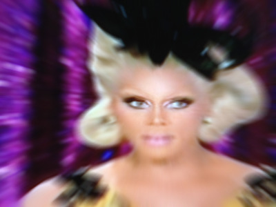 "Here's Miss RuPaul's smokin' hot look for her Drag Race season 4 ""finale,"" which aired this week. In many ways, Season 4 was unlike any of the previous seasons, as contestants were put through a battery of challenges never before seen on the show. The finale was no different with its cliff-hanging shocker. Instead of crowning a winner this week, fans now have a week to tweet their choice via the tag: #DragRace. The winner will be revealed on the April 30 ""reunion"" show on Logo. (I'm pulling for Sharon Needles)  Photo is screen shot of a LOGO program. Digital imagery: Have Gone, LLC"