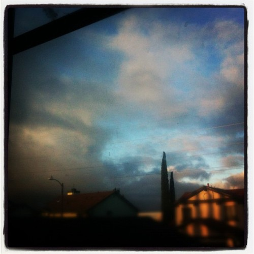 Watching the clouds clear and the sun rise. (Taken with instagram)
