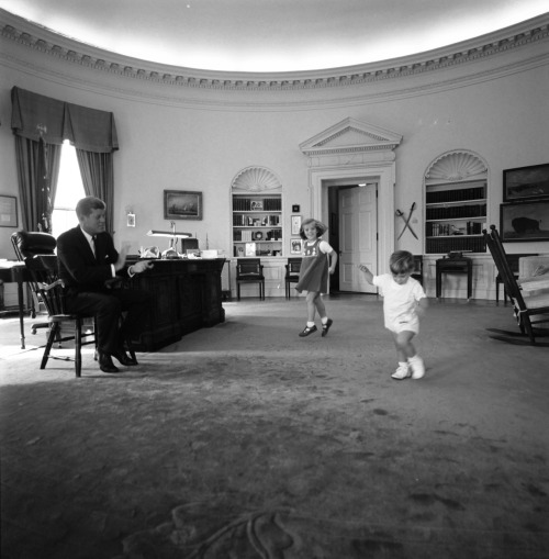 jfklibrary:  Happy Take Your Child to Work Day! Here's a photo of President Kennedy with his children, Caroline and John Jr., in the Oval Office. (Cecil Stoughton/White House)