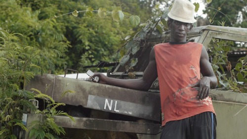 First days of shooting  Meet Peppe, a Ndyuka gold miner in central Suriname. Peppe is currently relaxing in front of the remains of a Dutch Army jeep parked by the banks of the Saramacca River. In addition to being a gold miner, Peppe writes and performs reggae songs in Sranan Tongo.