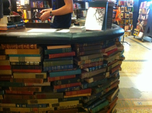 amiwithani:  The cash wrap is composed out of old hardcovers at The Last Bookstore in Los Angeles. (While in LA I also learned about the Portland, OR, store tradition of handing you a beer while you browse records. This is a marvelous innovation that I hope NYC picks up on soon, hint hint, Word/Greenlight/McNally.)