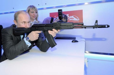 Russian Prime Minister Vladimir Putin Putin aims at a target with a replica of the AK-47 assault rifle in a shooting gallery while attending an exhibition of Russian Railways' research center in Moscow, Thursday, April 26, 2012. (RIA-Novosti, Alexei Druzhinin, Government Press Service)