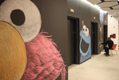 Many of the walls at Sesame Workshop, the non-profit behind Sesame Street, are big chalk boards. So it only makes sense that artists who work at Sesame Workshop turned them into huge murals of Elmo, Cookie Monster, and more. One of the artists talks about the process — and shows some more of his work — over on our blog.