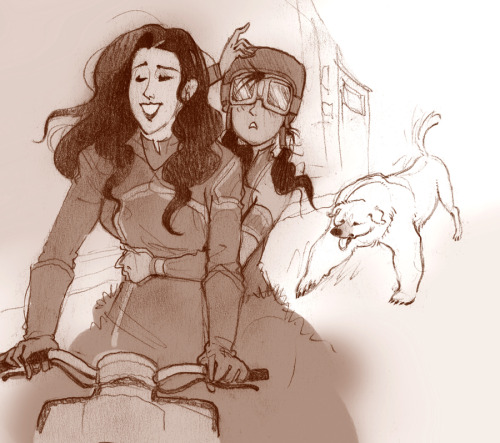 direwolfhugs:  [Image: Art of Asami taking Korra for a ride on her motorcycle. Korra is clutching Asami with one hand and her helmet with the other, as if she can press it extra-firmly onto her head, just in case. Where Korra has goggles and a helmet and looks a bit overwhelmed, Asami has no protective gear whatsoever and just looks free and happy at the wheel. Naga follows behind them.] theoeuvre:  korra and asami doodle. helmet safety for the avatar! …ok i know but. SHE HAS WHEELZ.