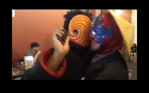Tobi from Naruto hugging a luchadore (actually THE El Topo Chico) in a tux and a straw hat at Anime St. Louis. THIS IS WHY I NEED TO START GOING TO CONS! P.S. And he tries to bodyslam a Heartless and it punches him in the dick!! P.P.S. And then he autographs a DEATH NOTE!!!