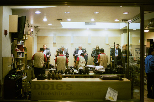shoe shining // rockefeller center - nyc, ny // leica m4 i'm used to seeing shoe shining places dwindle with few customers, but this place was full and busy. nice to see.