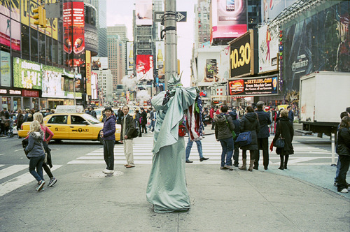 lady liberty // time square - nyc, ny // leica m4 a shy lady liberty (or guy). i guess i was suppose to pay before i could take a picture of her/him?