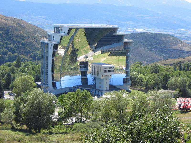 the world's largest solar furnace is located in Font-Romeu-Odeillo-Via, a commune in the sunny Pyrenees mountains on the French-Spanish border….  the furnace consists of a field of 10,000 mirrors that bounce the sun's rays onto a large concave mirror which focuses the enormous amount of sunlight onto an area roughly the size of a cooking pot which reaches temperatures above 3,000 °c or 5,430 degrees fahrenheit.