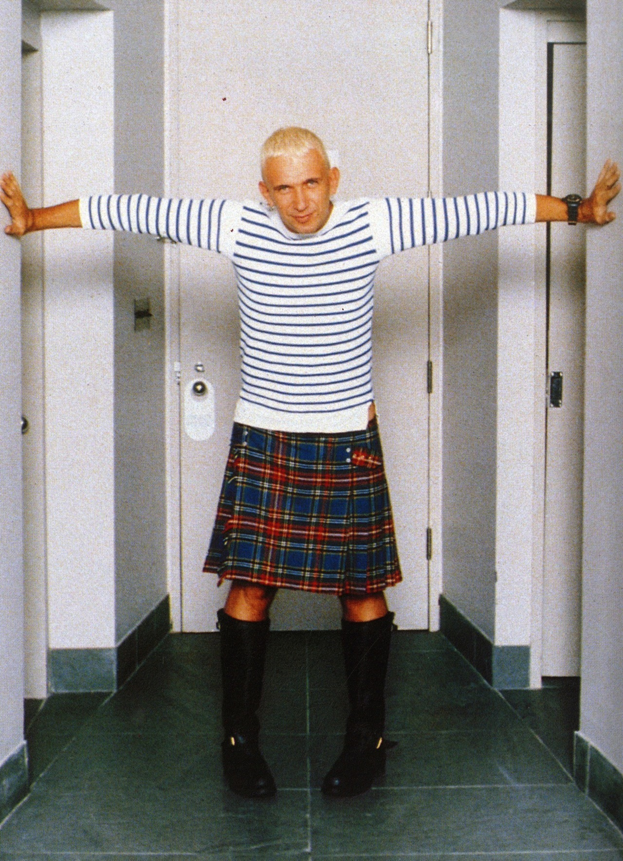 Jean Paul Gaultier in his classic kilt, sailor top, and boots. Elle 1994