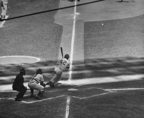 Ralph Morse—Time & Life Pictures/Getty Images  Jackie Robinson slashes a base hit during Game 6 of the 1955 World Series.