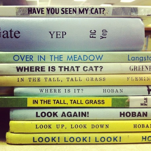 "kicksandgiggles:  leftyjenkins:  book spine poem - missing cat (Taken with instagram) In hindsight, I wish I'd switched ""OVER IN THE MEADOW"" and ""WHERE IS THAT CAT?"".  Read it that way and it sounds much better.  This is awesome, Lefty!"