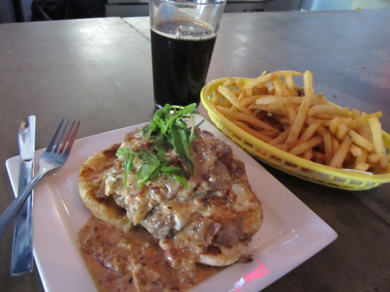 """Burger Stand's Breakfast Burger w/ Duck Fat Fries and a pint of Blind Tiger Java Porter in Topeka, KS."" Photo by Stefan B. Help Stefan win Womply's Favorite Eats Photo Contest by clicking the photo and hitting ""Like""! To learn more about the contest, click here."