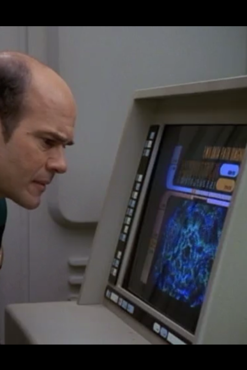 This is a picture of the holographic doctor from Star Trek Voyager. He is looking at a computer. He is a computer looking at a computer. I think in this episode his operating system was corrupted and he was developing Alzheimer-like symptoms. How many computers are looking at computers in our world today? Probably a lot. I'll be posting many more pics of Star Trek doctors in the near future.