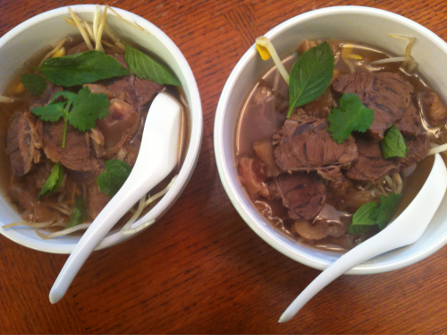 Two bowls of pho. Super healthy dinner. No noodles but lots of extra sprouts and herbs. Beef and tendon too.