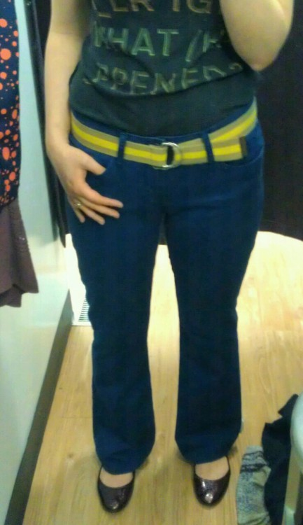 "5'6"" tall/ waist 29.5""/ hip 40"" Old Navy blue stretchy bootcut, size 29/8R $15, Buffalo Exchange as comfy as these were, they were ultimately a no. they looked kinda charming belted, but I was really only tempted by them for nostalgic reasons: they look and feel like lazy summer pants I had in younger, skinnier days. the truth is that these pants were too big, and I know I would regret them in a very short time. meanwhile: an 8 that is too big for me? I can tell you right now I have a pair of size 8 Old Navy capris sitting in my summer clothes box because I hope that I will one day fit into them again. same brand, same supposed size, vastly different fit on the same person. doesn't seem right, does it?"