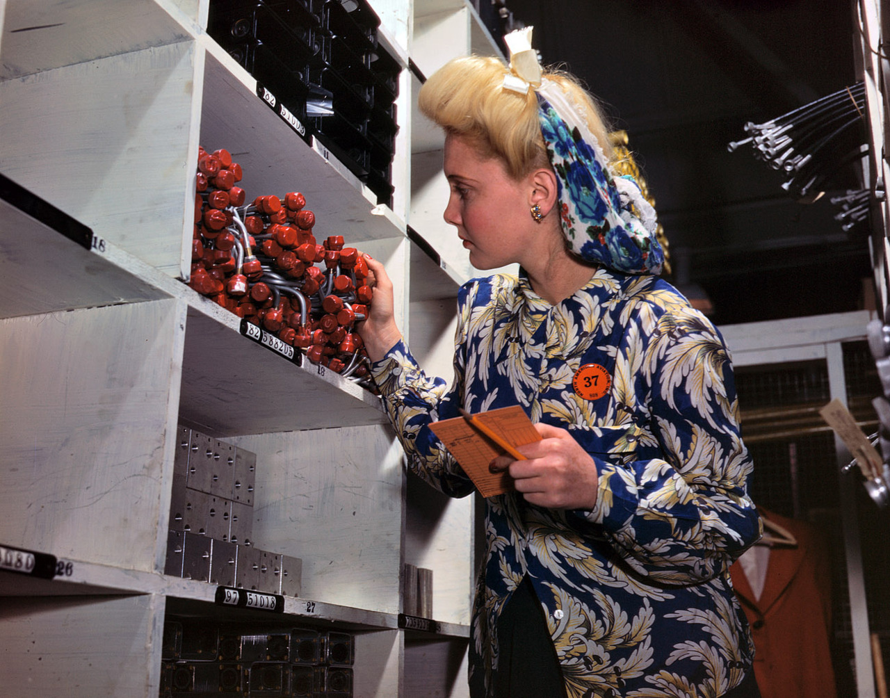 "October 1942. ""Clerk in North American Aviation stockroom, checking to see if the proper numbers of parts were received and placed in the proper bin. Inglewood, California. This plant produces the battle-tested B-25 (Billy Mitchell) bomber, used in General Doolittle's raid on Tokyo, and the P-51 (Mustang) fighter plane which was first brought into prominence by the British raid on Dieppe."" 4x5 Kodachrome transparency by Alfred Palmer. (via shorpy)   70 years later, and I think she is the most fashionable, fabulous woman I have seen in ages."
