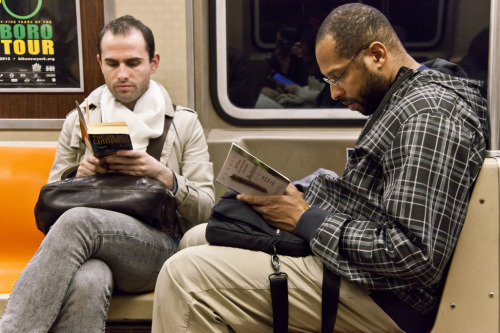 "unypl:  on the left he's reading ""The Golden Compass"", by Philip Pullman. on the right he's reading ""101 Things Everyone Should Know About Judaism: Beliefs, Practices, Customs, And Traditions"", by Richard D. Bank. Read The Golden Compass  I Read 101 Things Everyone Should Know About Judaism  But how are you reading the final pages of The Golden Compass and not tearing your face off?"