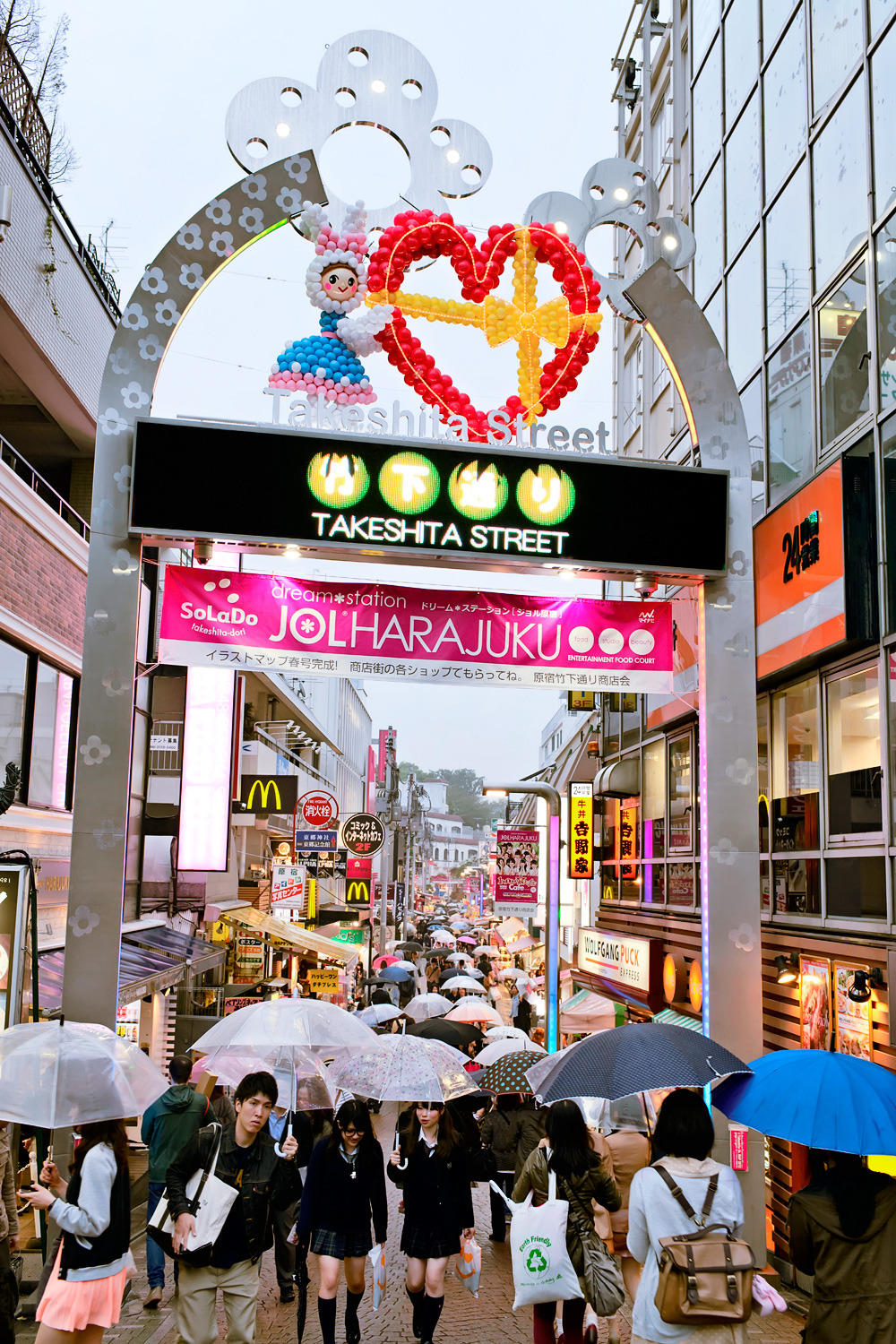 Light rain falling in Harajuku this evening.
