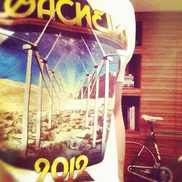 fresh shirt and new tire for the fixie (background) #coachella #fixie #fixedgear (Taken with instagram)