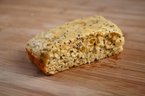 muffintop-less:  Lemon Poppy Protein Bars Ingredients: Cooking oil spray 1 1/3 cups white whole wheat flour (or gluten free flour) 2 scoops vanilla whey protein powder 1 cup Splenda granulated or 2/3 cup sugar (or Stevia/Truvia can be used) 2 tablespoons poppy seeds 2 teaspoons baking powder ½ teaspoon baking soda ½ teaspoon salt 2 teaspoons lemon zest 1½ cups nonfat plain Greek yogurt ¾ cup unsweetened applesauce 1 tablespoon canola or macadamia nut oil 2 ½ teaspoons lemon extract 2 eggs Directions: 1. Preheat oven to 325°F. Coat a 9×13″ pan thoroughly with cooking oil spray.2. In a large mixing bowl, combine flour, whey, Splenda, poppy seeds, baking powder, baking soda, salt, and zest; stir to mix.3. In a separate large mixing bowl, stir together yogurt, applesauce, oil, lemon extract, and egg. Add dry ingredients to wet ones, and stir just until uniformly moistened. Pour batter into pan.4. Bake 25 minutes or until toothpick inserted in center comes out clean. Do not overbake. Cool 5 minutes before slicing. To keep moist, wrap each bar in plastic wrap and store in refrigerator or freezer. Microwave briefly to reheat. Makes 12 servings (http://askgeorgie.com/?p=2389) Per serving: 125 calories, 3 g total fat, 1 g saturated fat, 40 mg cholesterol, 15 g total carbohydrate, 2 g dietary fiber, 3 g sugar, 10 g protein, 261 mg sodium.