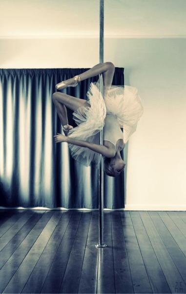 i love the combination of ballet costume on pole :)