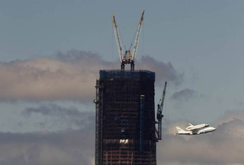 reuters:  The Space Shuttle Enterprise rides atop a NASA modified 747 plane over New York April 27, 2012. The Space Shuttle Enterprise officially arrived in New York to be placed at the Intrepid Sea, Air and Space Museum, [REUTERS/Lucas Jackson]   America, summed up in one photo.