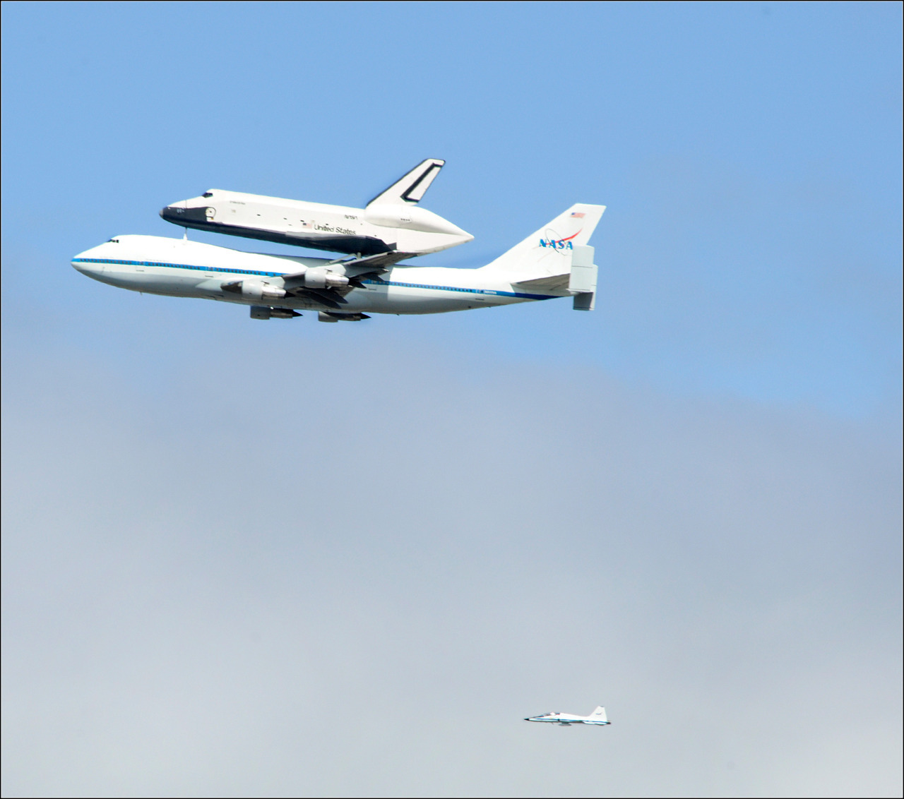 amnhnyc:  We spotted NASA's Space Shuttle Enterprise as it passed by the Museum this morning! This is the view from our rooftop. Photo by Rod.