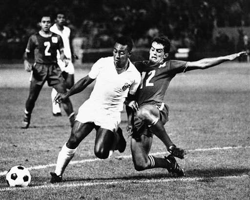 "xiquarterly:  Pelé in the United States - not in the NASL, but playing for Santos against the NPSL's Oakland Clippers in a friendly at the Oakland Coliseum on August 30th, 1967, in Oakland, California. Here he is driving past the Clippers' Trond Hoftvedt to score in the first half, later scoring again in the second half to lead Santos to a 3-1 victory in what was described as a ""record crowd"" of 29,162 in Oakland. (AP Photo)"