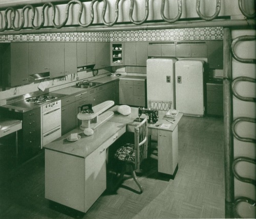 updownsmilefrown:  Kitchen sewing center, 1953